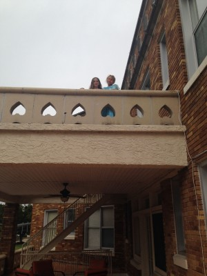 The girls playing princess on the balcony.